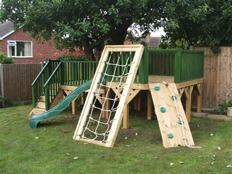 backyard cing ideas for kids bespoke split level play area around a tree treehouses
