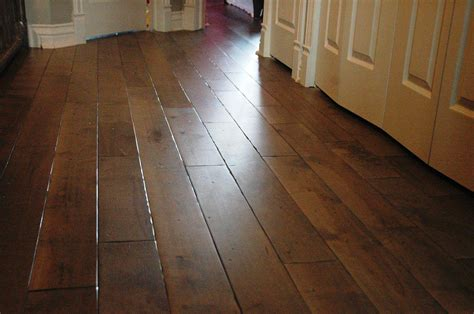 wide plank distressed oak hardwood flooring in kitchen
