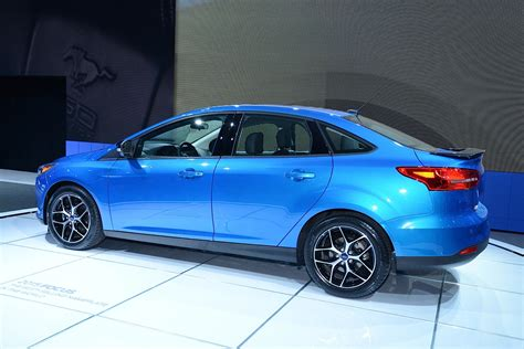 the evolving design themes of the 2015 ford mustang 2015 ford focus sedan and electric debut at new york auto