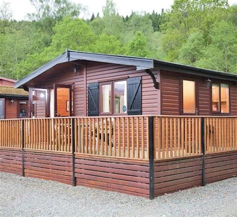 Log Cabins With Tubs In Loch Lomond by Loch Lomond Park