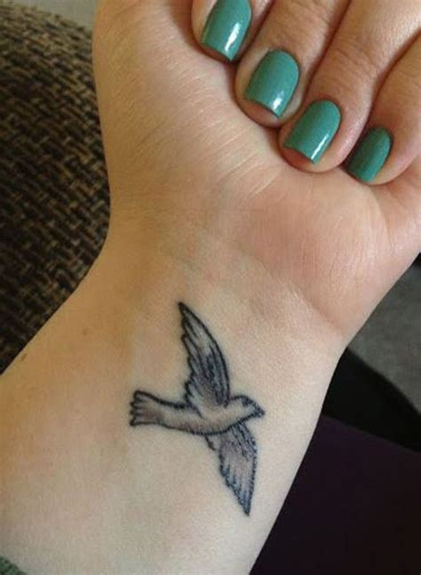 flying bird tattoo 53 awesome birds wrist designs
