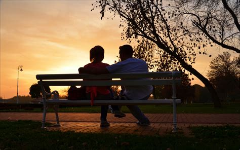 lovers on a park bench park bench couple love sunset wallpapers13 com