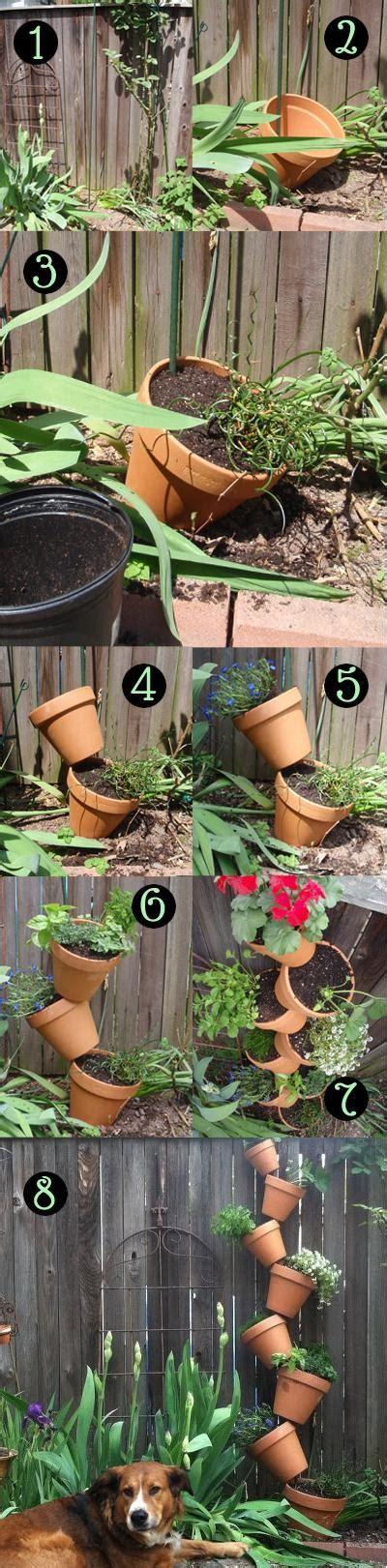 create a vertical garden with terracotta pots world in green