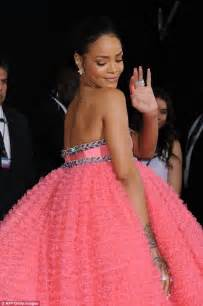 Hang Picture Without Nails rihanna struggles to walk in a gigantic pink tulle gown at