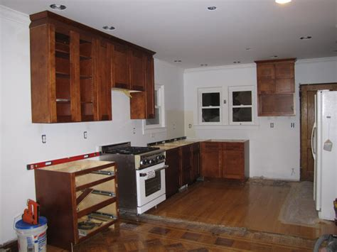 kitchen cabinets to the ceiling do your kitchen cabinets go all the way to the ceiling