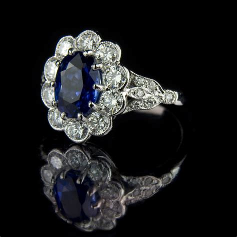 oval sapphire with cluster engagement ring flickr