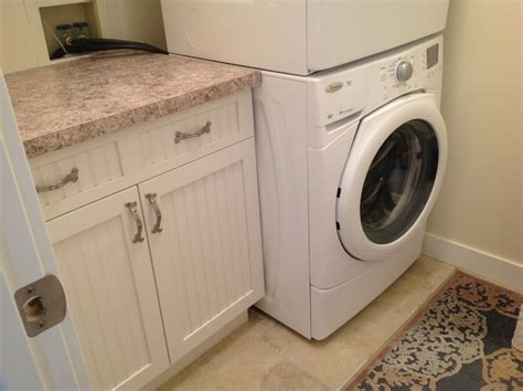 laundry design consultancy serene lake house beach style laundry room other