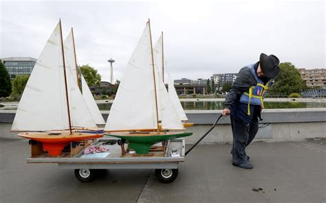 center for wooden boats volunteer model boats in a rolling regatta at lake union in seattle