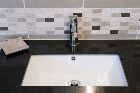 tile bathroom sink subway ceramic backsplash tile black granite countertop