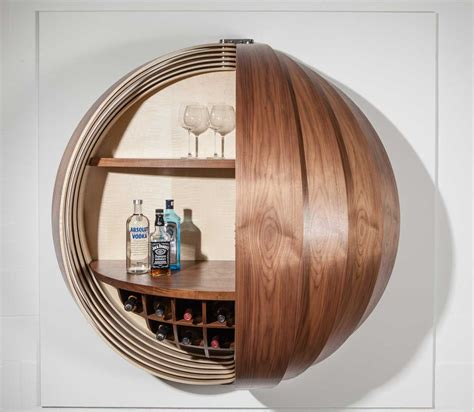 how to mount kitchen wall cabinets a wall mounted bar cabinet inspired by a spinning coin