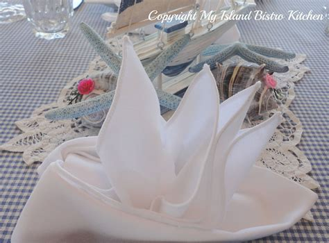 how to fold a paper napkin boat sailboat napkin fold tablescapes table settings