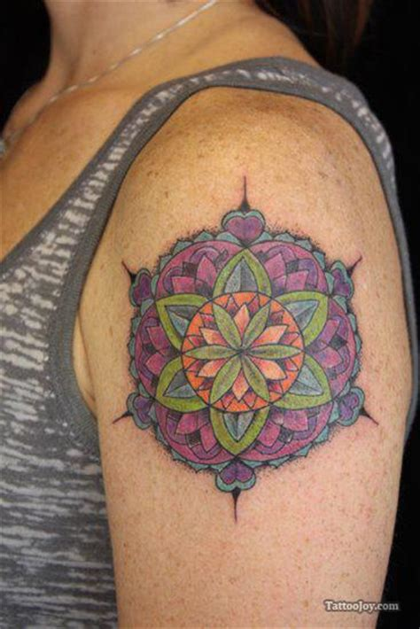 the colors and patterns of this feminine mandala tattoo