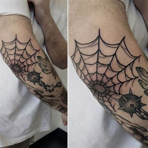 elbow spider web tattoo amazing black ink spiderweb on in school