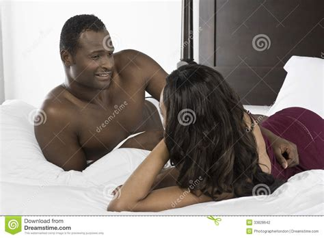 african men in bed african american couple lying in bed stock photography image 33828642