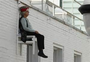 Old people sitting in chairs high above ground in montreal angie heisl