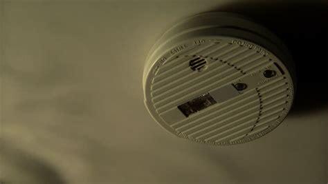 Alert Smoke Detector Blinking Light by Smoke Detector With Smoke And Alarm Light Stock