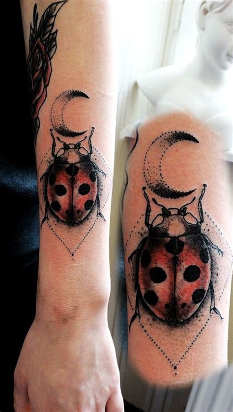 stippling style colored forearm tattoo of lady bug with