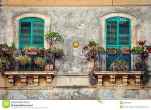 Mediterranean House Design Beautiful Vintage Balcony With Colorful Flowers And Doors