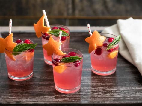 cocktail garnish fun with fruit add a fruity festive touch to your cocktail with an orange skin star and frozen