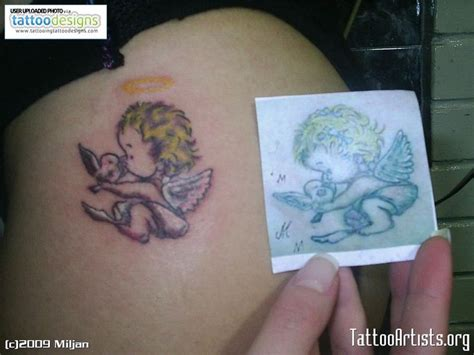 tattoo of angel holding a cross collection of 25 baby angel holding cross roses tattoo
