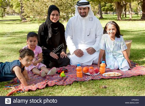 images of family portrait of arab family picnic in the park stock photo