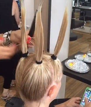 ponytail haircut technique hairdresser at m m friseure salon pulls woman s locks into