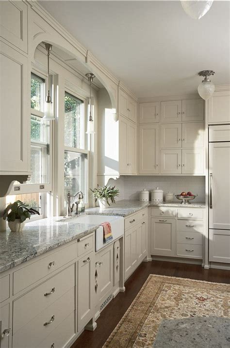 white kitchen cabinets gray granite countertops dark