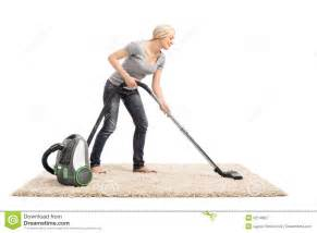 Carpet Cleaner Machine Woman Vacuuming A Carpet With Vacuum Cleaner Stock Image