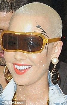 amber rose face tattoo steps out with mike tyson inspired etching