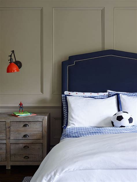 upholstered twin headboard contemporary boy s room wall paneling added character to this little boy s room