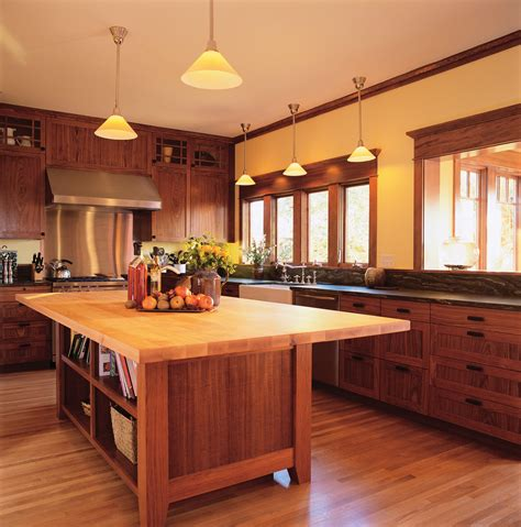 do you tile under kitchen cabinets do you install hardwood floors under kitchen cabinets