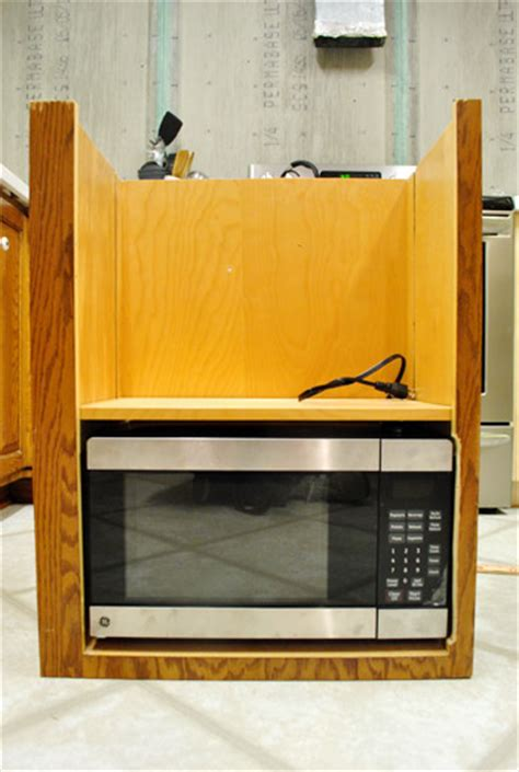 how to hide a microwave building it into a vented cabinet