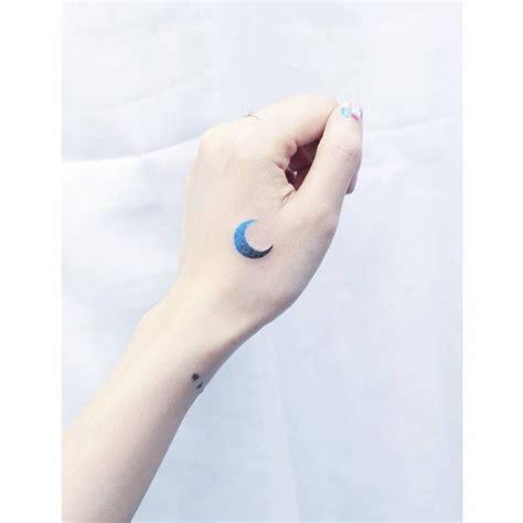 tattoo hand mini blue spectrum moon tattoo on the left hand tattoo artist