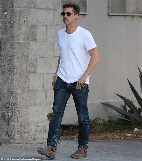 brad pitt channels james dean in jeans and white shirt