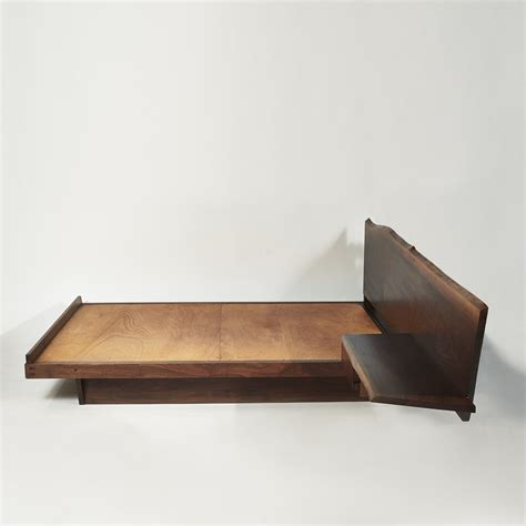 george nakashima platform bed with cantilevered slab headboard and side table usa 1957 todd