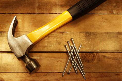 14842959   hammer and nails on wood   WoodFloorDoctor.com