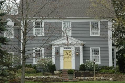 gray house yellow door adorable exteriors holly mathis interiors