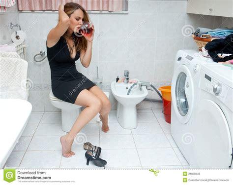 drunk in bathroom attractive woman drunk in her bathroom royalty free stock photos image 21058648