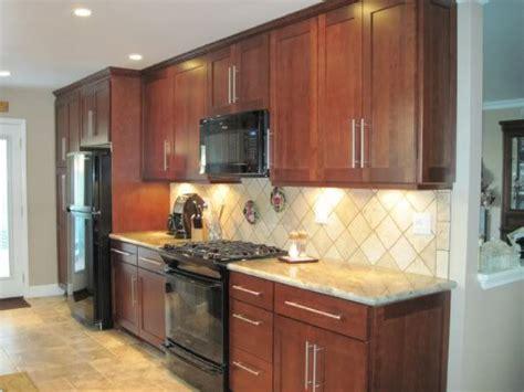 cherry cabinets  black appliances tile patterns