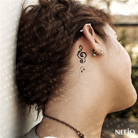 small music note tattoo small note feminine ear tattoos book