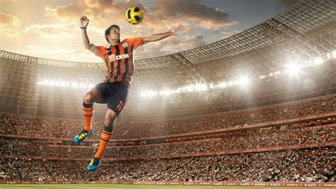 desktop wallpaper video player soccer player hits the ball wallpapers and images