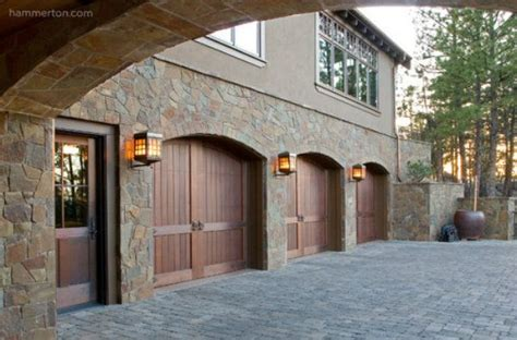 Outdoor Garage Light A Row Of Traditional Outdoor Light Fixtures From Hammerton S Chateau Collection Adds A Sense Of