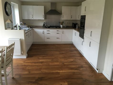 Want a wooden effect kitchen floor?   Red Carpets Leicester
