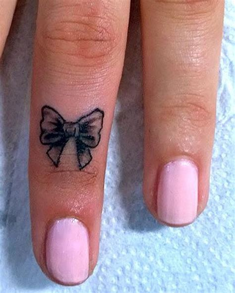 small bow tattoo on wrist 31 girly word finger tattoos