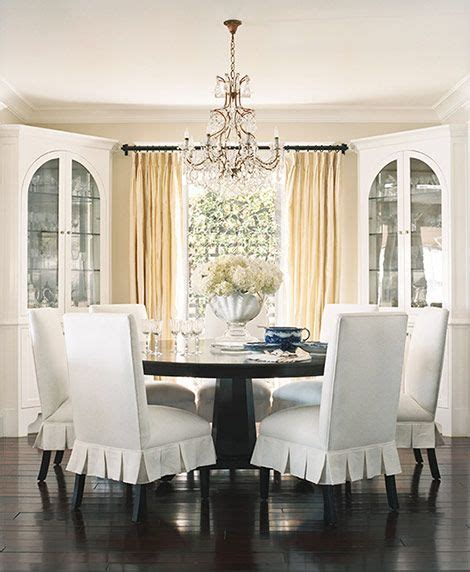 bright colored slipcovers dining room love the chandelier and the light bright