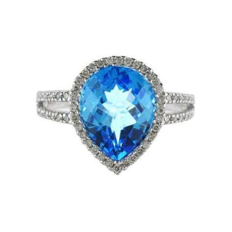 pear shaped blue topaz and cocktail ring 14k white
