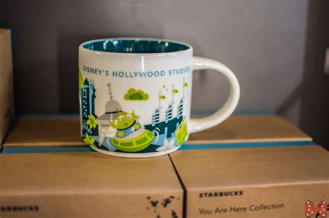 Starbucks Dw Mug Snowflakes 2017 Collection new studios starbucks quot you are here quot mug features swirling saucers mickey