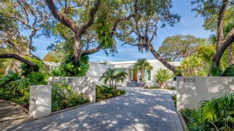 oak  palm tree lined driveway  front  home hgtv