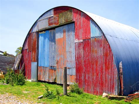 before after a shed goes from farmhouse to modern round metal shed with mismatched paint stock photo image