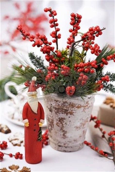 christmas decorations with berries berries and greenery in clay pots vignettes centerpieces